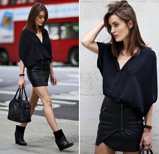 embedded_all_black_outfit_with_mini_skirt
